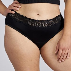 Front of model wearing black period underwear with lace waistband